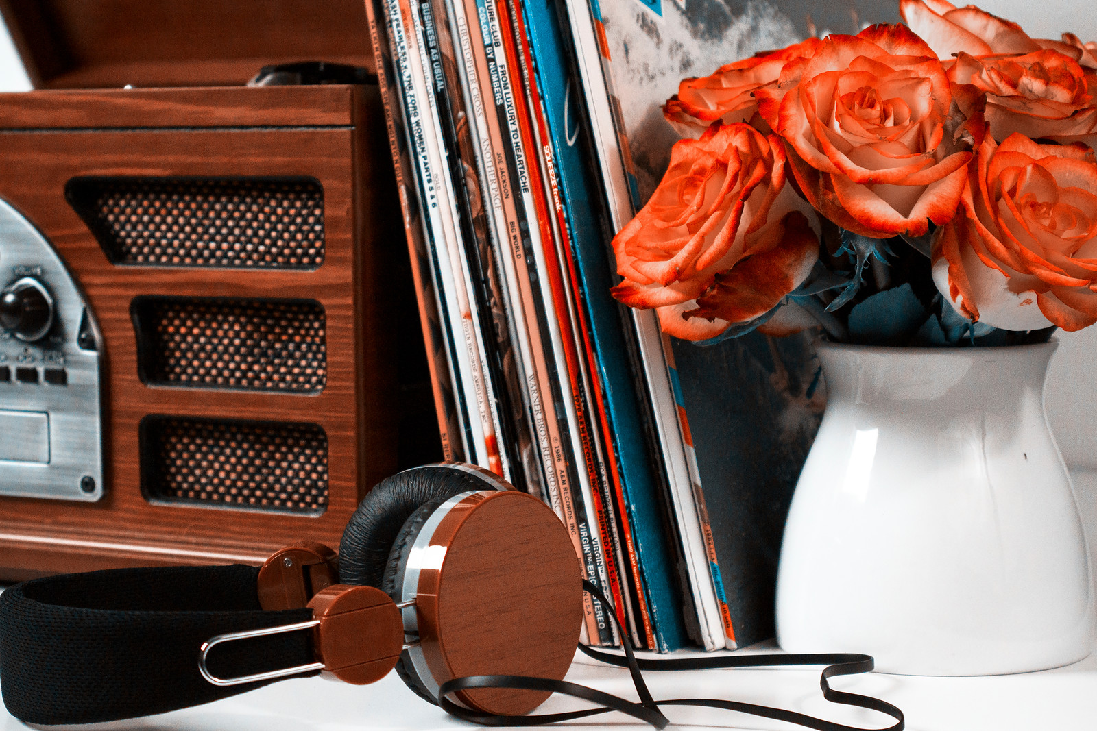 brown headphones, record player, flowers