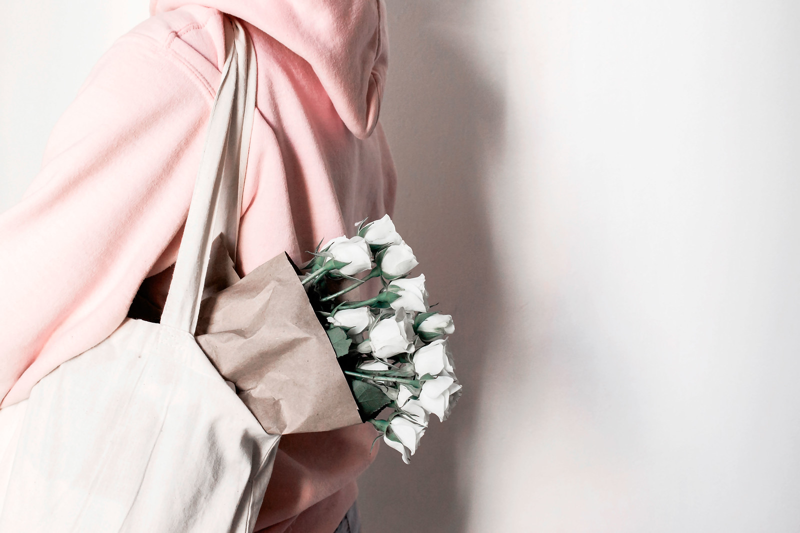person with a bag of flowers