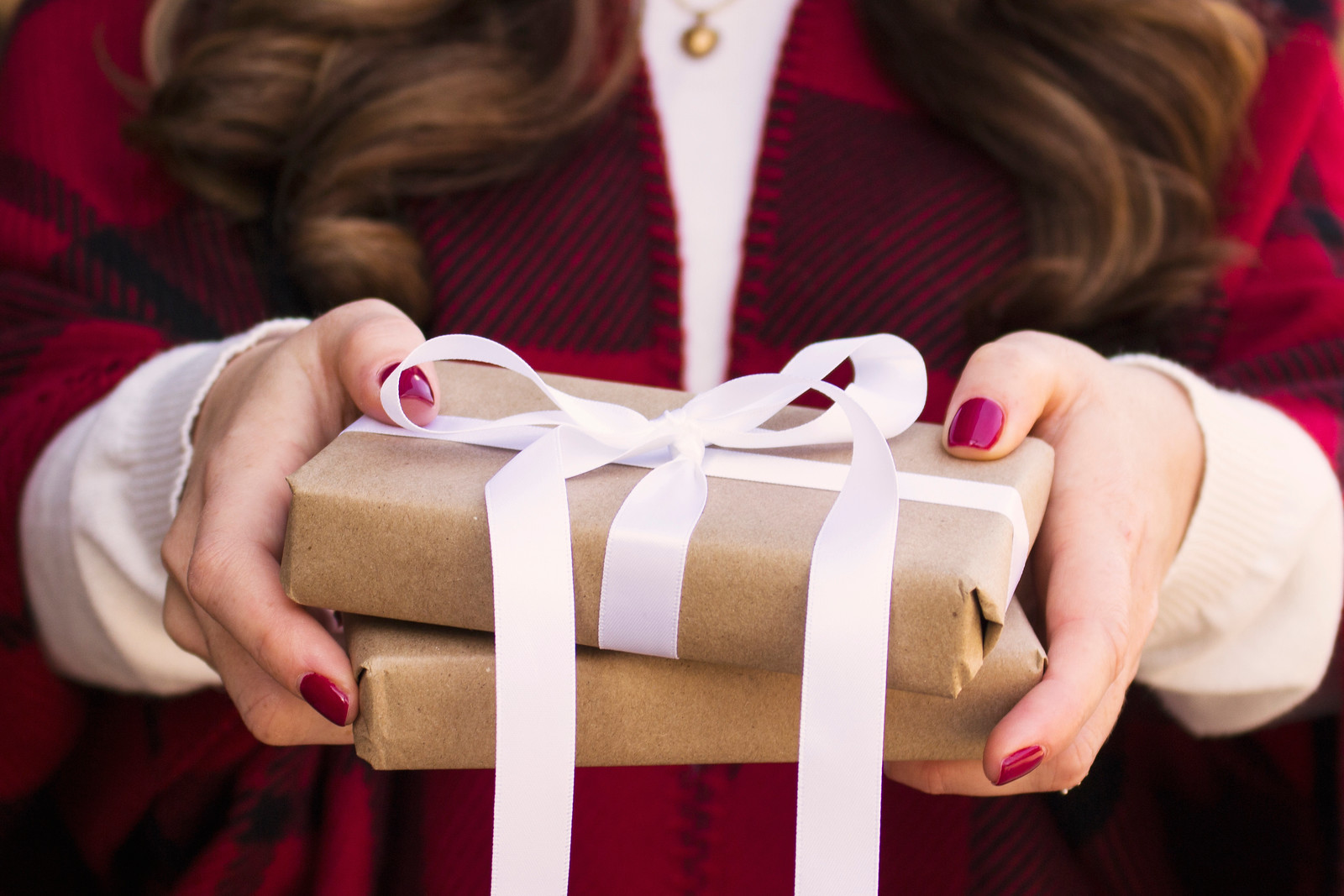 Woman holding presents wrapped gifts
